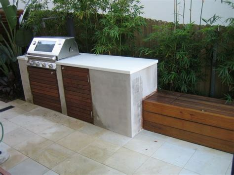 minimal concrete bench exterior bbqs fire