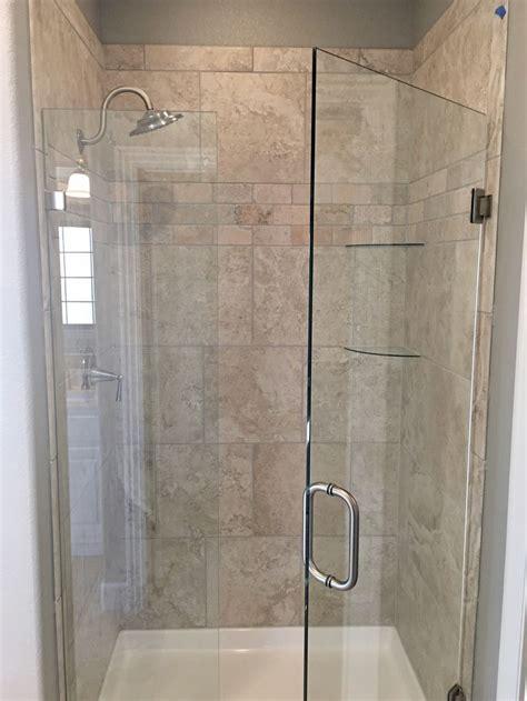 glass door shower  greige porcelain  travertine