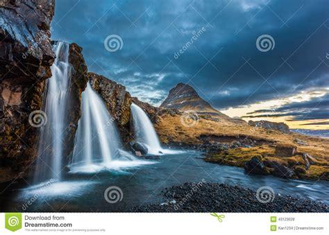 Waterfalls And Kirkjufell Sunrise Iceland Stock Photo