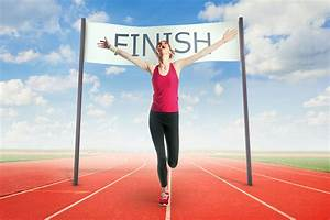Woman crossing the finish line - Inspiring Nuggets