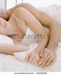 Young Man And Woman Lying Together In Bed Male Models Picture