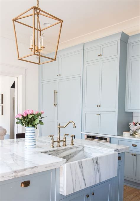 blue cabinets white countertops 30 gorgeous blue kitchen decor ideas digsdigs 328 | 02 serenity blue kitchen cabinets with white marble countertops and brass touches for a retro look