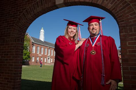 father daughter share commencement spotlight university louisiana