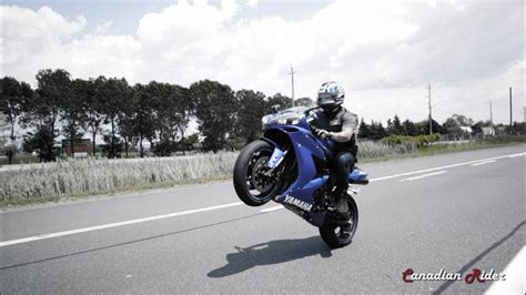 Crazy Motorcycles Doing Massive Wheelies Down The Highway