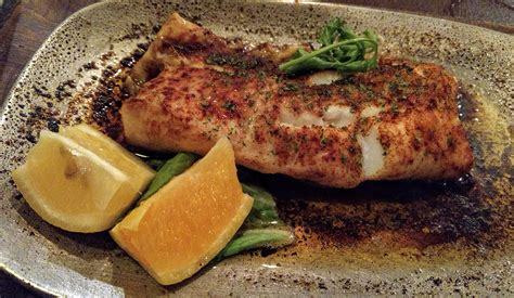 broiled scrod broiled scrod strip steak entrees are delectable at malcuit s tavern entertainment life