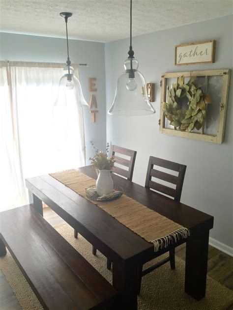 The distressed brick backsplash in this farmhouse kitchen by blesser house is, in fact, vinyl wallpaper. Dining Room Decor! Farm house table/ pottery barn pendants/ magnolia wreath/ farmh… | Farmhouse ...