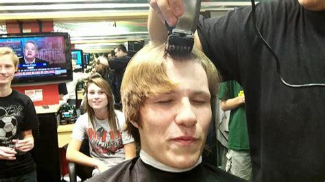 bloomingdale high school boys cross country team heads shaved
