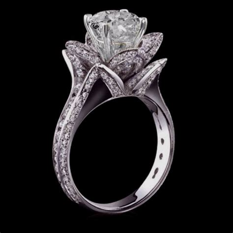the most beautiful wedding ring i ve ever seen love the way it s shaped like a flower when