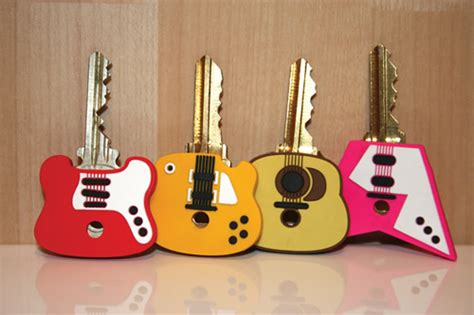 guitar shaped key caps set   glam rock kikkerland