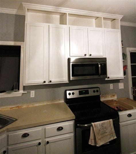 designs of kitchen cabinets with photos how to extend kitchen cabinets to the ceiling home 9583
