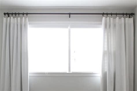 how to hang curtains to make your windows look bigger