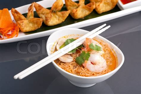 cuisine chinoise shrimp and noodle soup bowl with chopsticks along