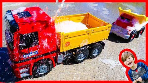 bruder dump trucks   truck wash youtube