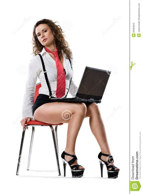 Young Businesswoman Sitting On Chair With Laptop Stock