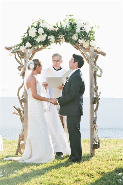 curly wood wedding arbor  white floral garland
