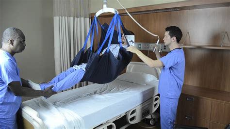 transfer from bed to wheelchair using repositioning sling