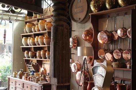 coppers confit jars paris flea copper pots display