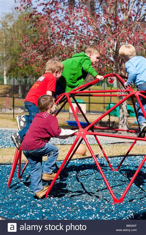 preschool boys on jungle playground equipment 270 | preschool boys playing on jungle gym playground equipment at preschool B80AKF