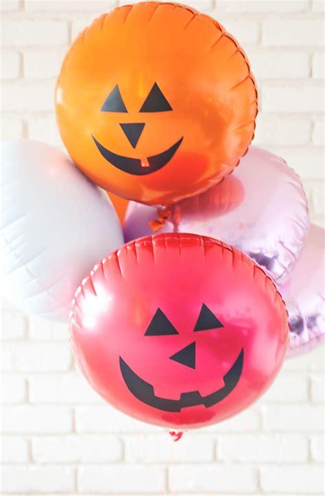 jack  lantern face pumpkin balloons  subtle revelry