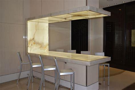 Kitchen Island Lighting Design - backlit onyx table stone lobby feature renaissance arlington gpi design