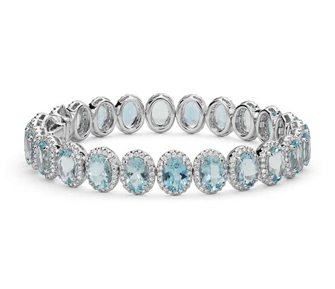 Aquamarine And Diamond Halo Bracelet In 18k White Gold. Ethical Rings. Flower Wedding Rings. Small Pendant. Performance Platinum. Cut Sapphire. Unique Wood Watches. Affordable Wedding Rings. Pregnancy Wedding Rings
