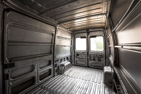 van turned tiny mobile home curbed