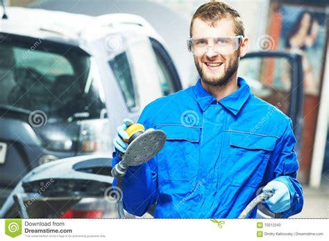 Portrait Of Auto Mechanic Worker With Power Polisher