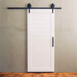 there s something special about a simple white barn door accompanied by black barn door hardware