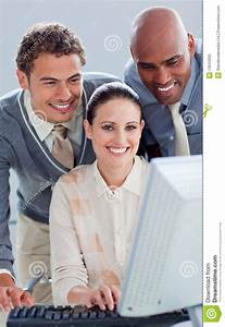 Young Business People Working At A Computer Stock Photo ...