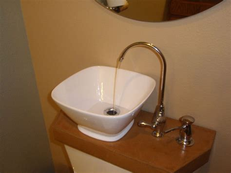 sink toilet tank alluring toilet with sink on tank combined bowl porcelain wash basin beside curves brass faucet