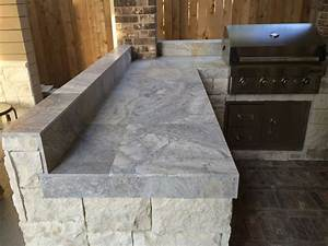 Houston outdoor kitchen with silver travertine tile countertop for Outdoor kitchen tile