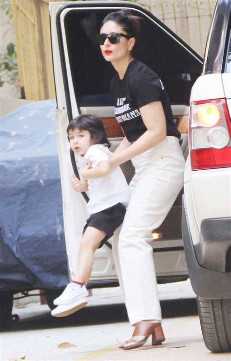 Bebo was seen wearing a black tank top with black skinny jeans and a black thin belt. Taimur Ali Khan's expressions while clicked with Saif and ...