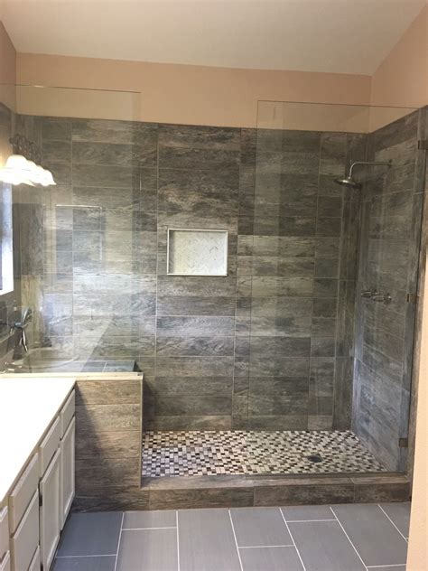 Walk In Shower Materials by Large Tile Shower With Shower Heads And Bench Seat