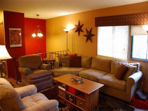 ideas elegant tan living couch feat red and yellow wall