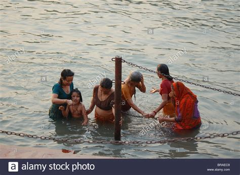Women Bathing In Holy River Ganges In India During Kumbh