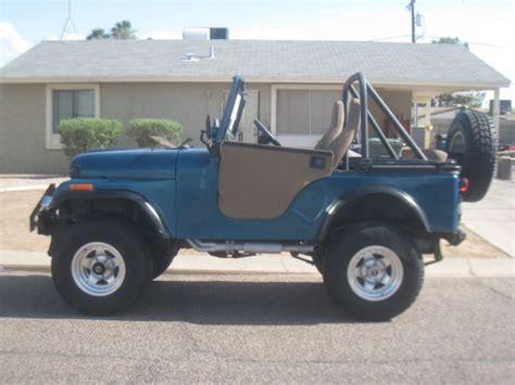 dark green jeep cj seller of classic cars 1971 jeep cj teal green tan and