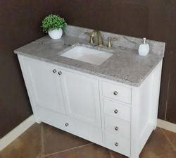"""At american standard it all begins with our unmatched legacy of quality and innovation that has lasted for more than 140 years.we provide the style and performance that fit perfectly into the life, whatever that may be. Tuscany® 49""""W x 22""""D Gray Forest Granite Vanity Top with Rectangular Undermount Bowl at Menards®"""