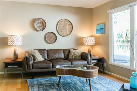 Bright Turquoise Rug look San Francisco Midcentury Living Room Image Ideas with beige wall blue