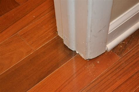 how to end laminate flooring at doorways cut door trim and stops for hardwood flooring installation in doors one project closer