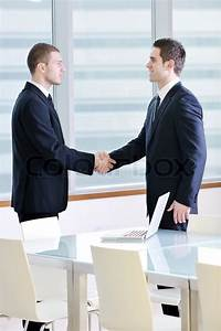 Two young businessman handshake on business meeting at ...