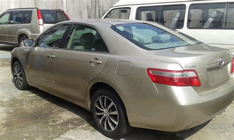 super bab toyota camry  model   le gold color