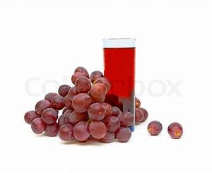Bunch of grapes and a glass of grape juice isolated on a ...