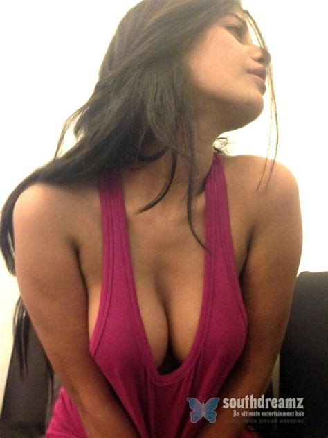 Poonam Pandey's toes on Young Boy's lips!