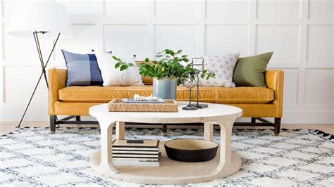 Our quick hacks for styling a round coffee table! How to Style a Round Coffee Table Video by Studio McGee. Watch more interior design and ...