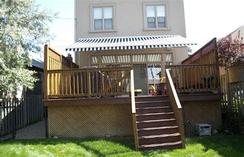 residential striped awning  deck rolltec retractable awnings toronto ontario canada