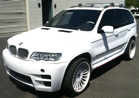 Change For Bmw color change for bmw suv to white custom vehicle wraps