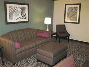 king suite 2 rooms 1 king bed sofa bed in attached room With king suite with sofa bed