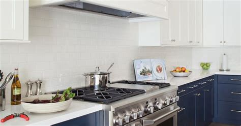 kitchen with backsplash kitchen with wood floors navy lower cabinets white 3492