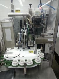 norden pac matic  automatic tube filler aevos equipment