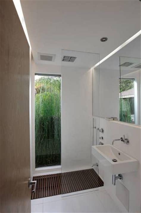 bathroom window with built in exhaust fan i looooove the full length window in the bathroom